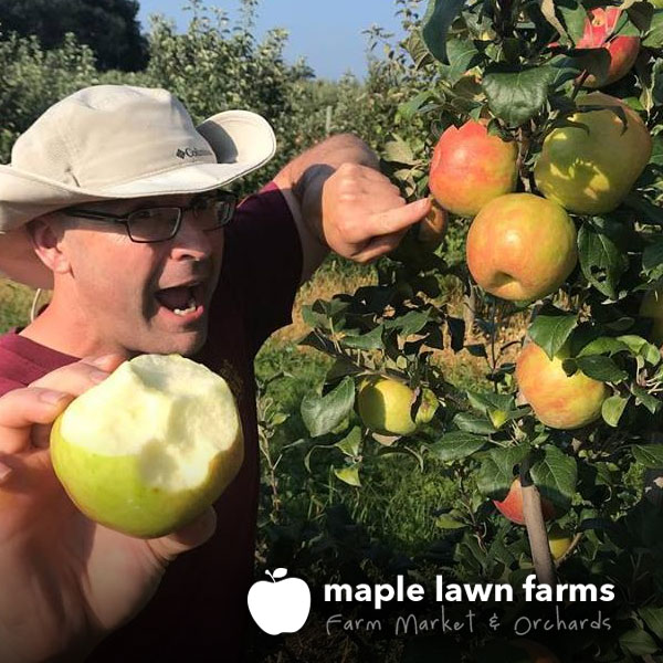 Maple Lawn Farms - Hugh in the apple orchard